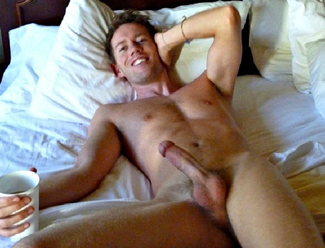 Happy Nude Man in Bed